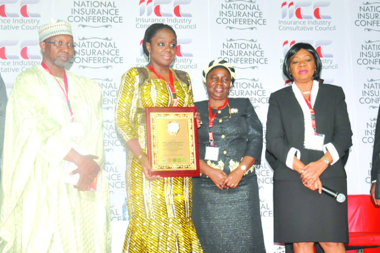 Mrs. Kemi Adeosun, Minister of Finance (3rd left) holding a plaque presented to her at the National Insurance Conference 2016, in Abuja, recently; to her right are Mohammed Kari, Commissioner for Insurance; and Mr. Eddie Efekoha, Chairman, Nigerian Insurers Association; to the Minister's left are Mrs Yetunde Ilori, Chairman, National Insurance Conference Planning Committee; Lady Isioma Chukwuma, President, Chartered Insurance Institute of Nigeria; and Mr. Ralph Opara, President, Institute of Loss Adjusters of Nigeria