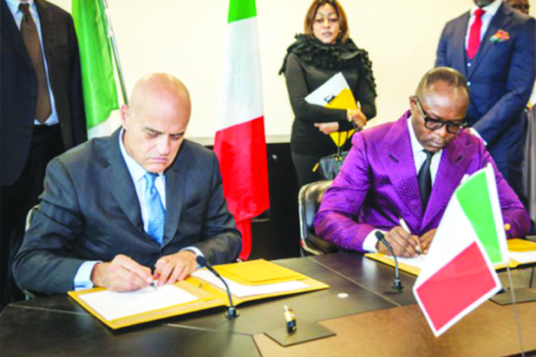 1-Kachikwu-right-signing-the-MOU-on-behalf-of-Nigeria-Descalzi-left-signed-on-behalf-of-Eni-450x450