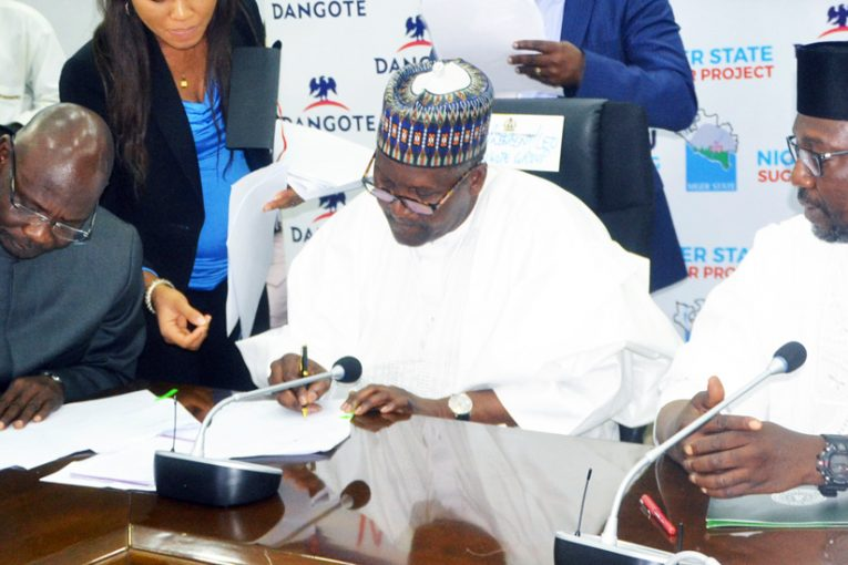 (L-R) Ag. Group Managing Director, Dangote Sugar Refinery Plc, Engr. Abdullahi Sule, Chairman, Dangote Sugar Refinery Plc, Aliko Dangote, Niger State Governor, Abubakar Sani Bello, at the MoU signing ceremony between Dangote Sugar Refinery Plc and Niger State Government on Sugar Project in Niger State, at Goverment House, Minna, on Wednesday, August 23rd , 2017