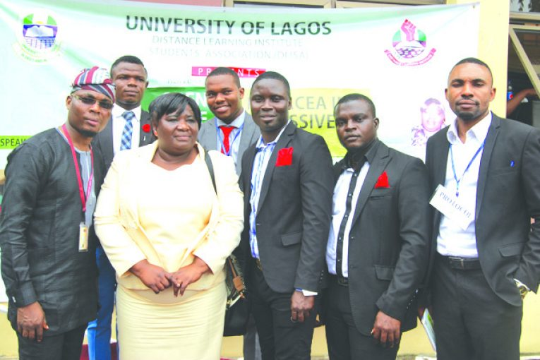 Dr. Olamide Esther Adesina, Director, Open and Distance Education, National University Commission, (2nd left); Charles Osarenwense, Chairman, Lecture Series Committee, (left); Olawoyin Oluwafemi Titius, President, Distance Learning Institute Student's Association (DLISA) (3rd left); Akpan Sunday Etim, Treasurer, DLISA, (2nd right) ; Cecil Dickson Gilbert, Lecture Series Committee, member (right); ThankGod Roberts, Lecture Series Committee, member (back left); Bidemi Titus, Lecture Series Committee, member (back right), at the first Annual Lecture Series Open Distance Education: A Panacea in a Recessive Economy organised by DLISA held in UNILAG, Lagos